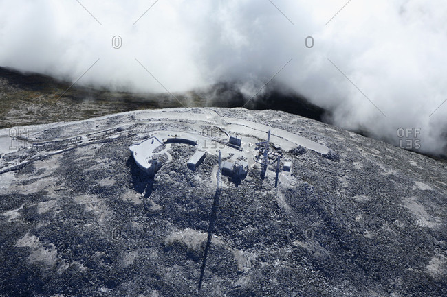 Aerial view of the weather research station atop the snow-dusted summit of Mt Washington just north of North Conway, NH