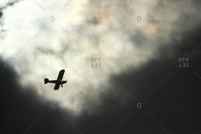 Light aircraft overflys the New River Gorge against a sky filled with ominous dark clouds near Fayetteville ,WV