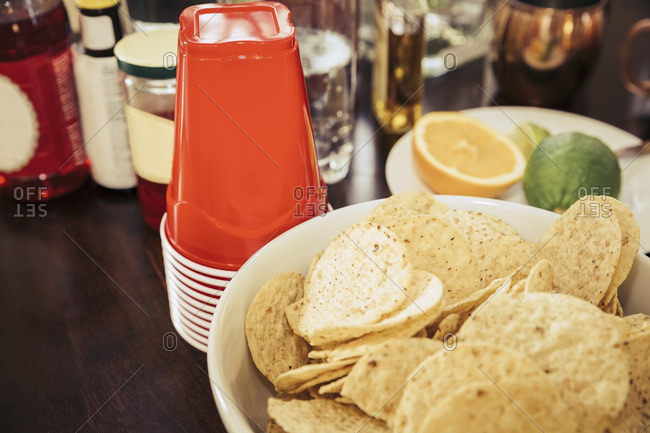 Tortilla chips and ingredients for mixed drinks at a party