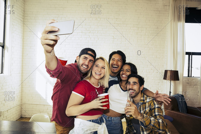 Group of friends at a party taking a selfie