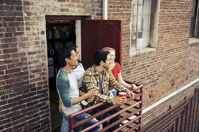 Group of friends hanging out together on a fire escape