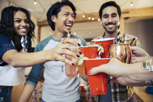 Friends toasting in celebration at a party