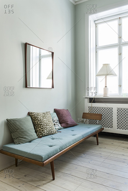 Futon with throw pillows in a living room