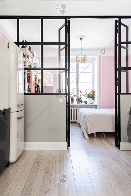 Pink bedroom with glass walls