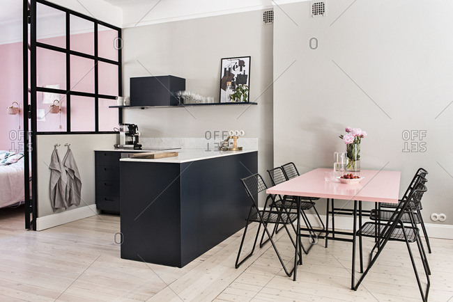 Stockholm, Sweden - July 8, 2015: Open concept kitchen and dining area in an apartment
