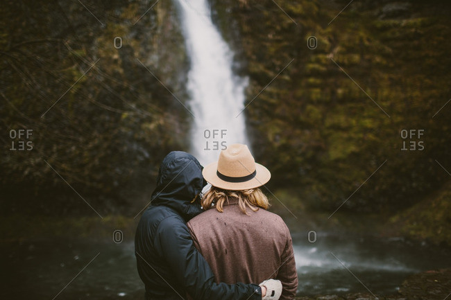 Rear view of couple looking at a waterfall