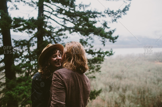 Couple standing by a tree preparing to kiss