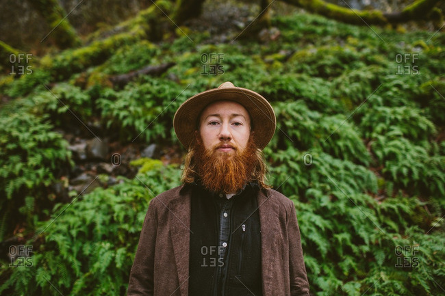 Portrait of a young hipster man with a beard