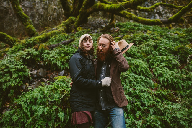Couple standing in the wilderness together