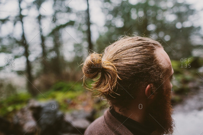 Young hipster man with a beard and a man-bun