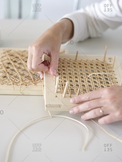 Woman weaving rattan whicker