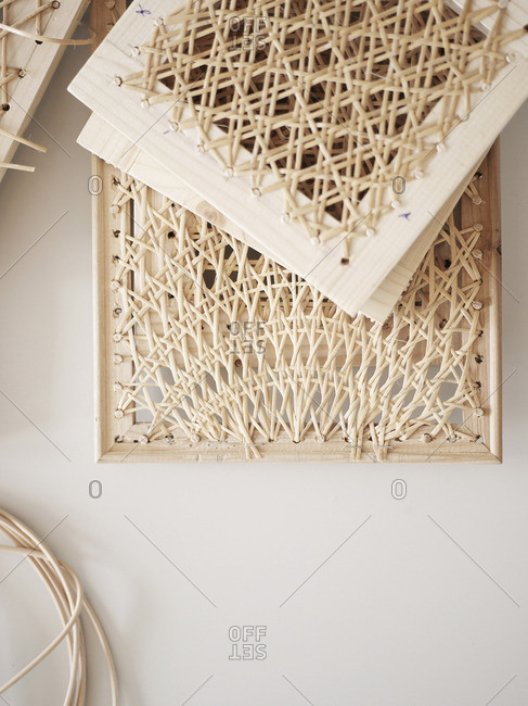 Close up of a woven rattan whicker on wooden frames