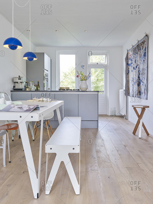 July 19, 2010: Open-concept kitchen and dining room with blue pendant lights