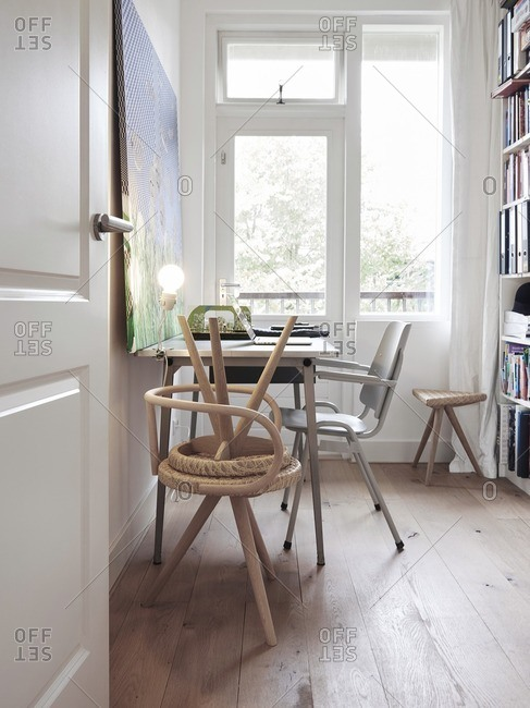Home office interior with bright windows