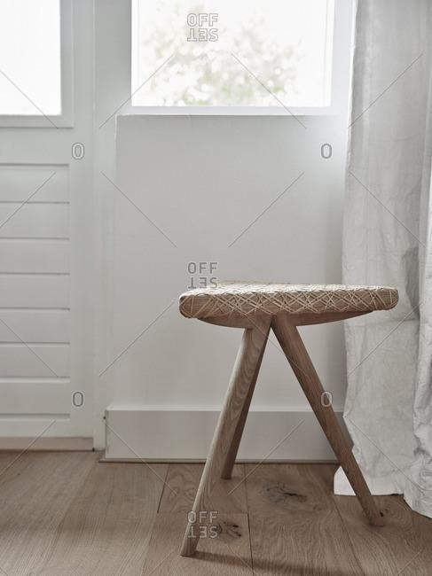 Three legged wooden stool