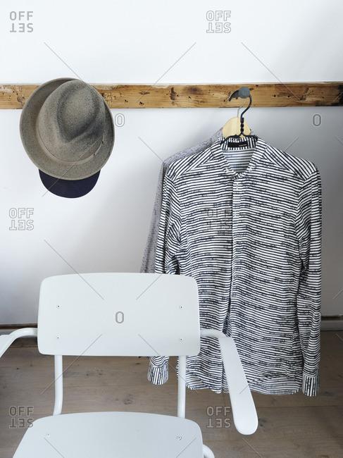 July 19, 2010: Clothes and hats hanging on a wooden board