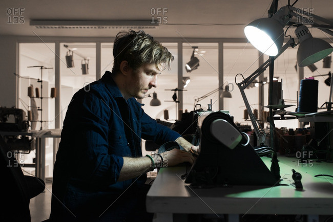 Tailor sewing denim on a sewing machine