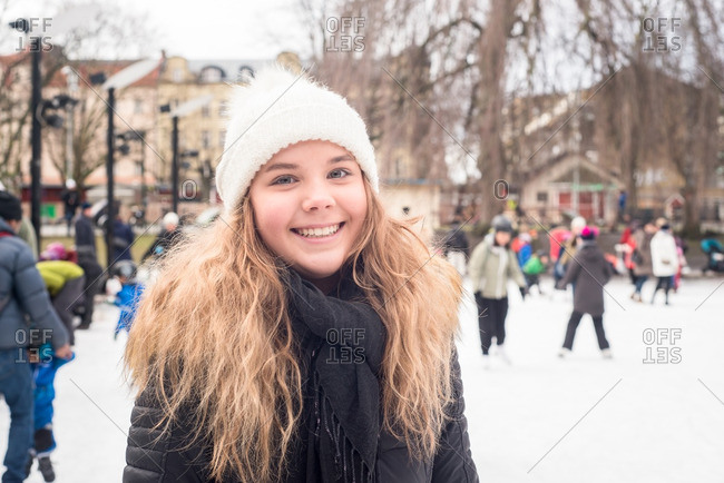 Smiling girl at an ice rink