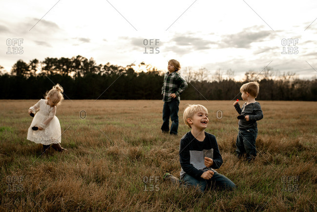 Children playing together in a country field