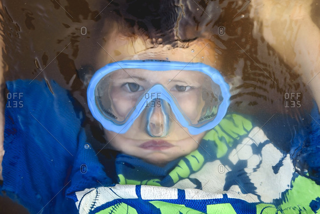 Boy with goggles underwater