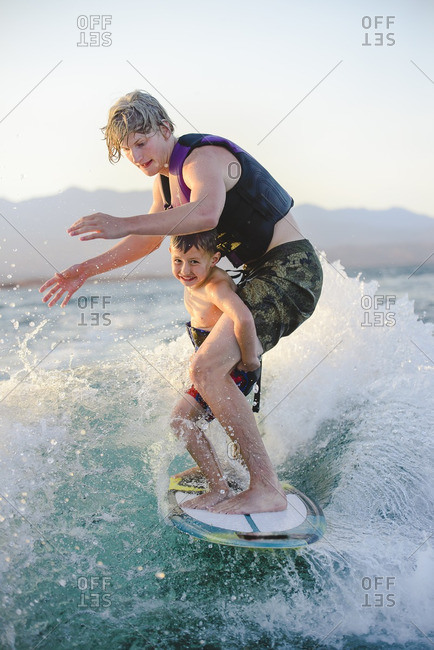 Brothers surfing together