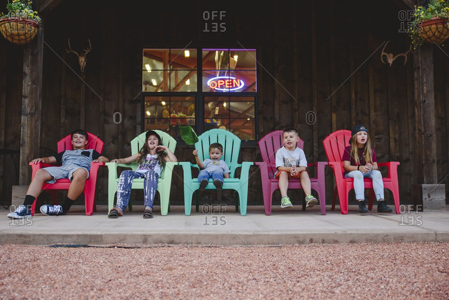 Kids sitting in colorful chairs