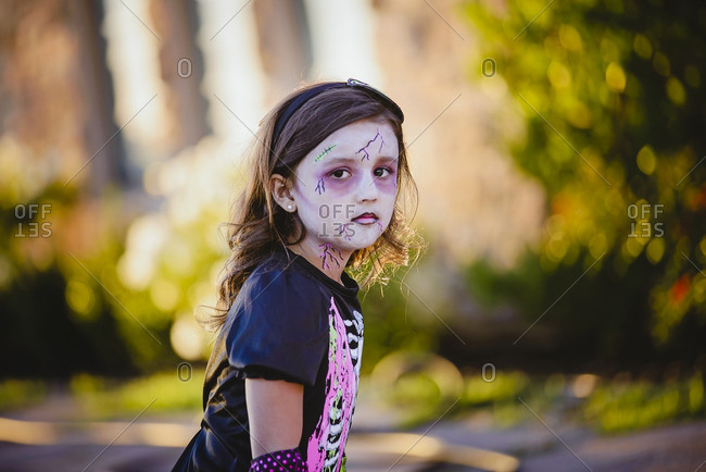 Girl in a zombie costume for Halloween