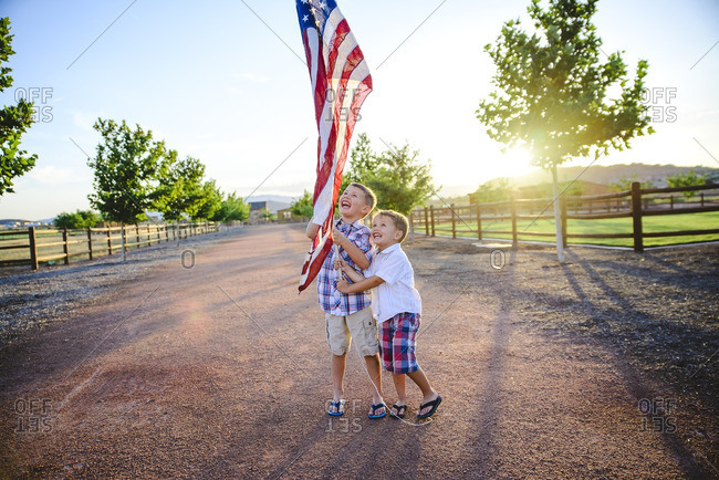 Two boys holding an American flag