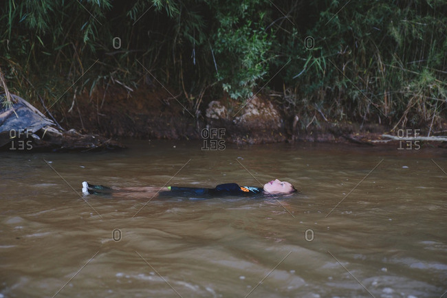 Boy floating down the river