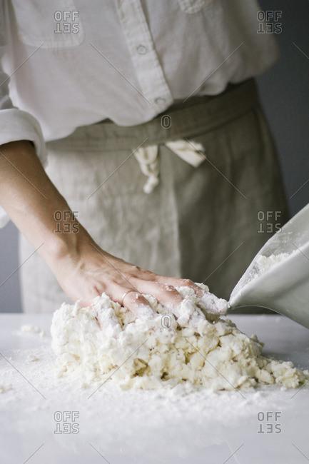 Person preparing a messy dough mixture