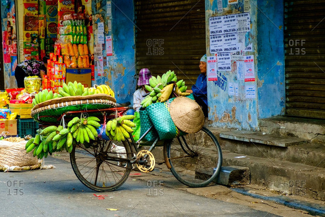 Hanoi, Vietnam - 7/9/16: Bicycle loaded with bananas to sell