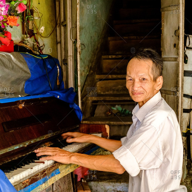 Hanoi, Vietnam - 7/9/16: Portrait of a man playing a piano