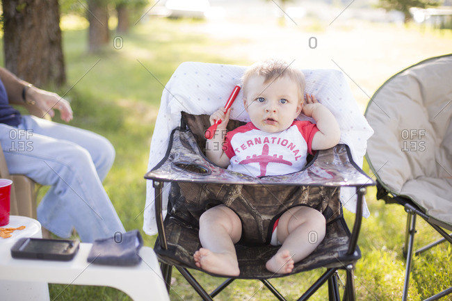 Baby sitting in outdoor camping chair