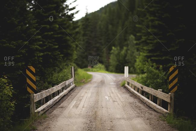 Narrow wooden bridge over creek