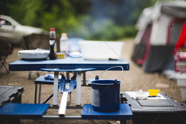Kitchen supplies on table at campsite