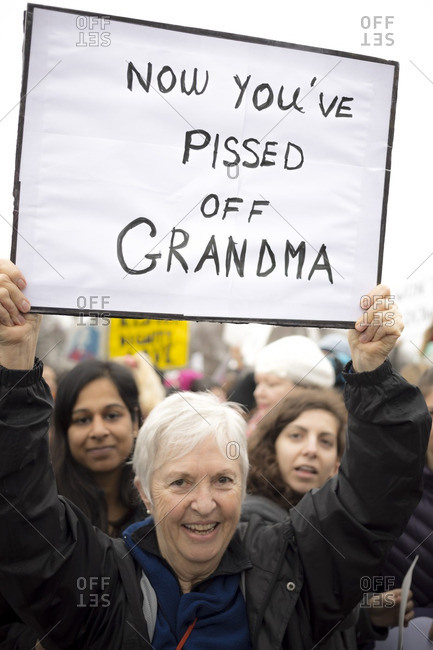"Washington, D.C., USA - January 21st, 2017: The Women's March from the US Capitol building down the Mall to the Whitehouse. Older woman holding a sign that says ""Now you've pissed off grandma"""