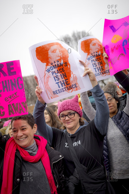 """Washington, D.C., USA - January 21st, 2017: The Women's March from the US Capitol building down the Mall to the Whitehouse. Women holding signs that say """"Woman's place is in the resistance"""""""
