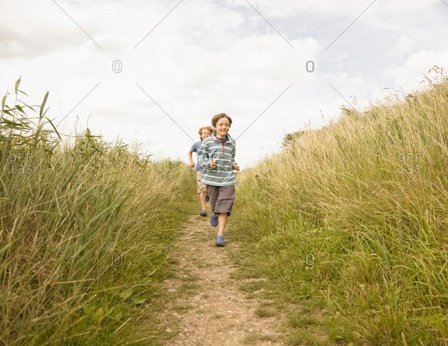 Boys running down path