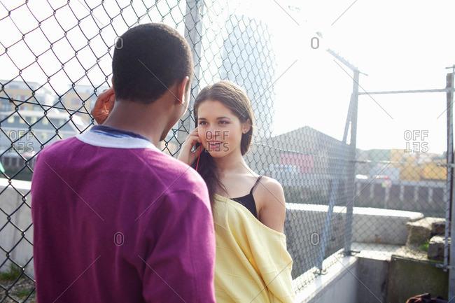 Couple talking on city street