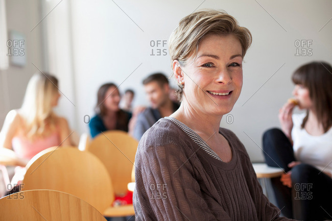 Older student smiling in classroom