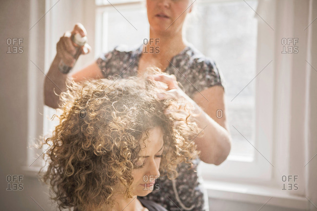 Hair stylist working on client