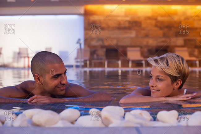 Couple relaxing in modern indoor pool
