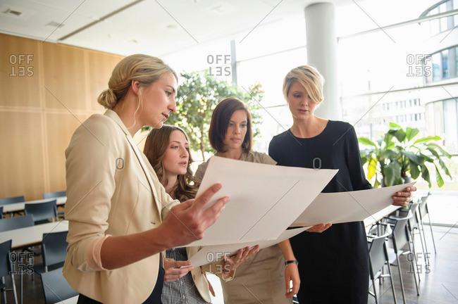 Businesswomen examining papers