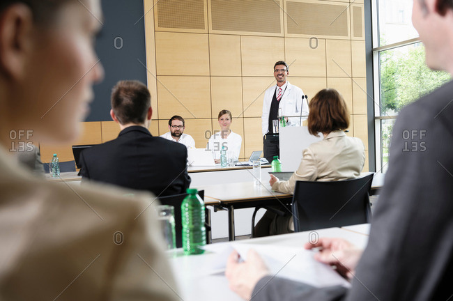 Doctors giving talk in conference room