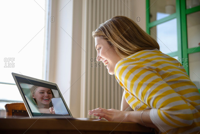 Young woman on video call with friend
