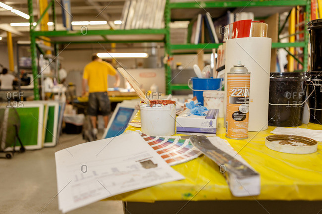 Ink and swatches on bench in screen printing workshop
