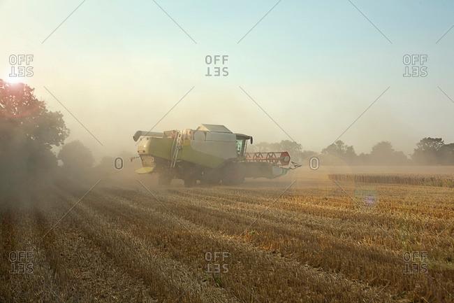 Combine harvester in field, Devon, England, UK