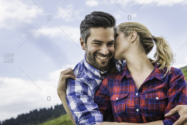 Couple hugging and kissing