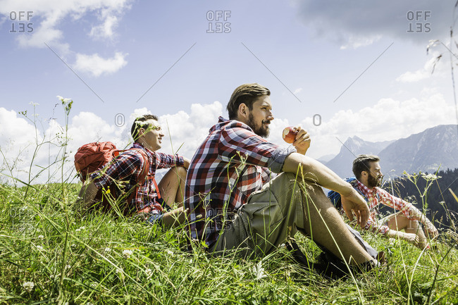 Male friends resting on hike, Tyrol, Austria