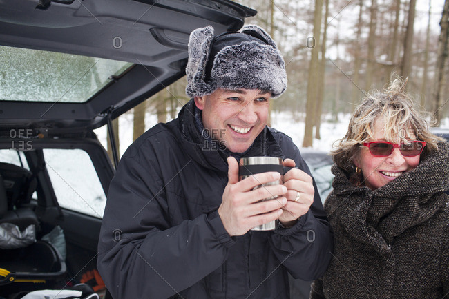 Mother and son having hot drink outside in winter